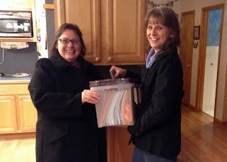 Loree hands off the Secretary Files to Dawn, our new Secretary.